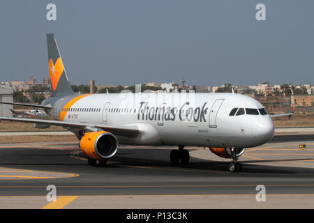 Thomas Cook Airlines Airbus A321 passenger jet plane taxiing on arrival in Malta. Air travel and tourism. British aviation, the EU and Brexit. - Stock Image