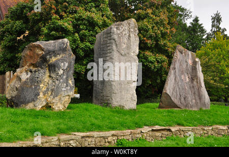 The ECOS standing stones in Frome around the amphitheatre,in the Community College. left Flinty Sandstone from the Netherlands, centre Portland limest - Stock Image