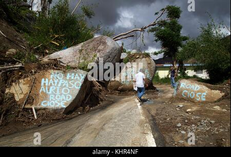 Large boulders that detached from the mountain during Hurricane Maria block a road November 12, 2017 in Naguabo, - Stock Image
