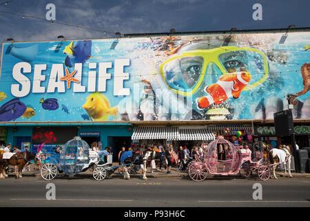 UK, England, Lancashire, Blackpool, Promenade, passenger carriages outside Sea Life Centre aquarium attraction - Stock Image