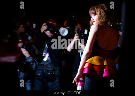 Actress Jaime Winstone is hounded by photographers before the PPQ autumn 2011 collection at the BFC Showspace at - Stock Image