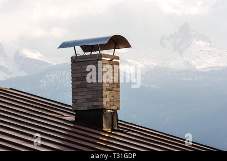 Picture of a chimney on the roof of a house in Cortina D'Ampezzo, Dolomites, Italy - Stock Image