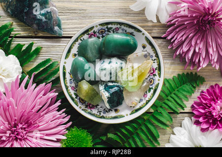 Decorative Plate with Green Aventurine, Tree Agate, Green Calcite, Clear Quartz, Moss Agate and Spring Flowers - Stock Image