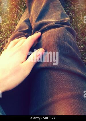 Hand on leg - Stock Image