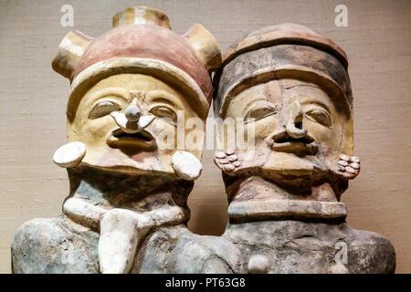St. Saint Petersburg Florida Museum of Fine Arts interior seated couple Ecuador ceramic polychromed details - Stock Image