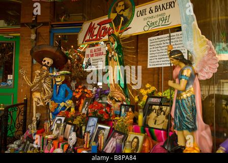 Day of the Dead altar display skulls skeletons large sunflowers Mi Tierra cafe bakery San Antonio Texas tx - Stock Image
