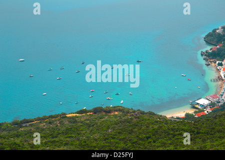 A beautiful bay with a beach, in the Arrábida Mountain, Portugal. - Stock Image