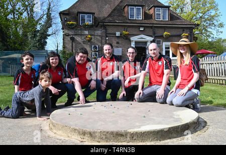 Crawley Sussex, UK. 19th Apr, 2019. The Swansea Bay Packers team at the World Marbles Championship held at The Greyhound pub at Tinsley Green near Crawley in Sussex . The annual event has been held on Good Friday every year since the 1930s and is open to players from around the world Credit: Simon Dack/Alamy Live News - Stock Image