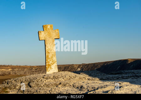 Old Orhei stone Cross in front of the old stone carved church - Stock Image