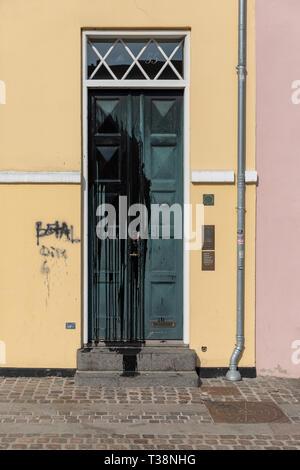 Vandalism; black paint thrown on front door of old house - Stock Image