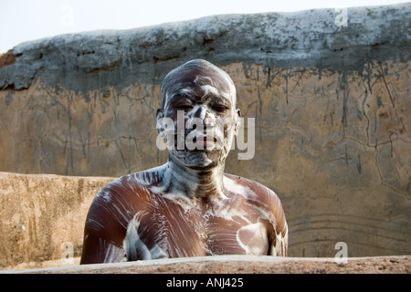 Ghanaian man well soaped in a mud wall shower Wechiau hippo sanctuary in north western Ghana - Stock Image