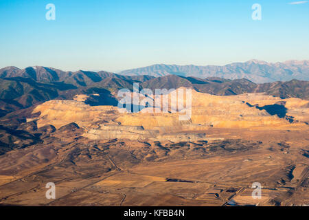 Bingham Canyon Kennecott Open Pit Copper Mine from the air in early morning light near Salt Lake City Utah - Stock Image