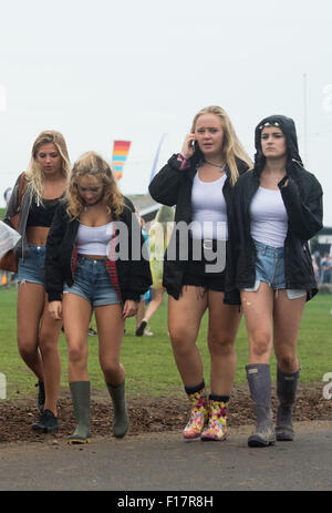 Portsmouth, UK. 29th August 2015. Victorious Festival - Saturday. A group of girls in shorts, t-shirts and wellies - Stock Image
