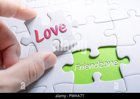 The Words Love And Friendzone In Missing Piece Jigsaw Puzzle - Stock Image