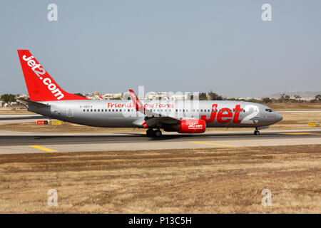 Boeing 737-800 commercial jet plane belonging to the British low cost airline Jet2 taxiing on arrival in Malta. Budget air travel. - Stock Image