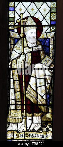 Stained glass window depicting St Gregory St Peter's Church, Deene, Northamptonshire - Stock Image