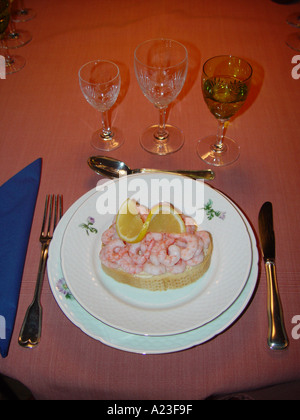 Open sandwich with shrimps on white bread on dining table Denmark - Stock Image