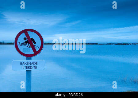Prohibitory sign : swimming forbidden above a lake - Stock Image