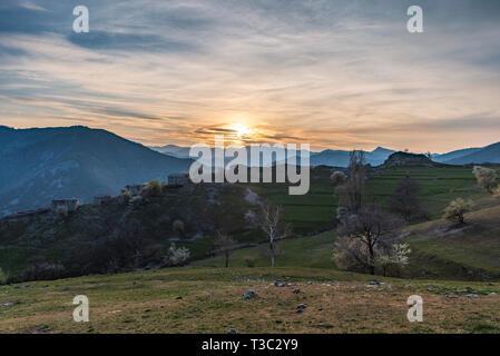 Abandoned village Mumdjidam in Rhodope mountain, Bulgaria. Piece of paradise during sunset. - Stock Image