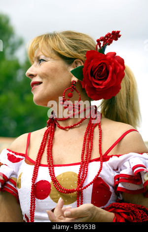 Beautiful blond middle aged Spanish woman in traditional costume at the Fuengirola Feria, Andalucia, Costa del Sol, - Stock Image