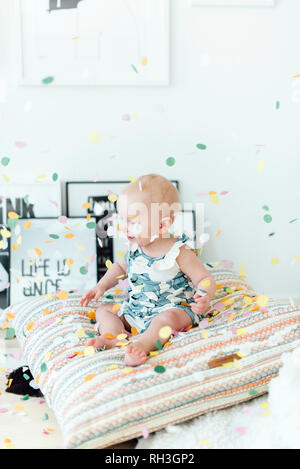 Girl with confetti flying around - Stock Image