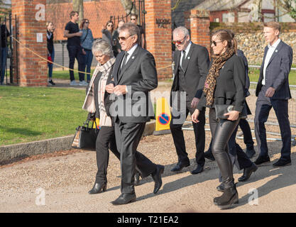Braintree, Essex, UK. 29th Mar 2019.  Funeral of Prodigy frontman Keith Flint at St Mary's Church in Bocking attended by hundreds of his fans Mourners arrive at the church Credit: Ian Davidson/Alamy Live News - Stock Image