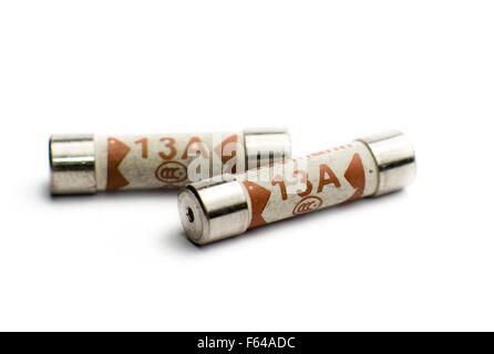UK Domestic 13A plug fuses on a white background. - Stock Image