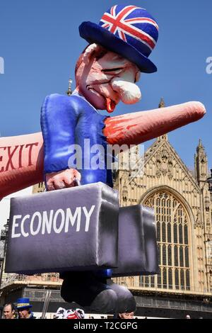 1st Apr 2019. Detail of a Pro EU Effigy of Prime Minster Theresa May which illustrates how Brexit will damage the economy. The effigy was originally created for the Dusseldorf Carnival in Germany. It was a key feature of the People's Vote March on 23.03.2019. Pro and Anti Brexit Protests, Houses of Parliament, Westminster, London. UK Credit: michael melia/Alamy Live News - Stock Image