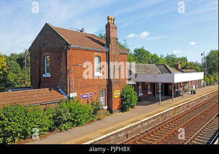 A view of the railway station on the Wherry Lines with old enamel signs still in place at Acle, Norfolk, England, United Kingdom, Europe. - Stock Image