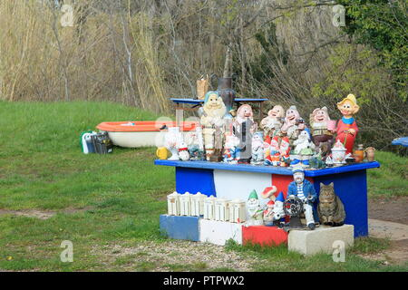 Cat between garden gnomes, Alpes Maritimes, 06, PACA, France - Stock Image