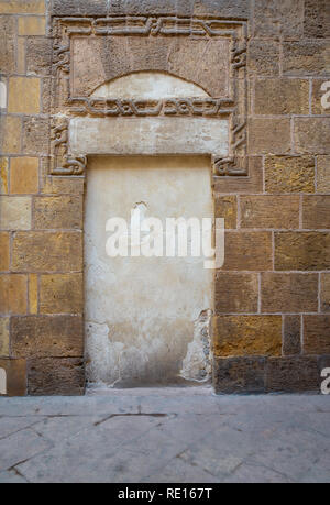 Recessed frame in an old stone bricks wall, Medieval Cairo, Egypt - Stock Image