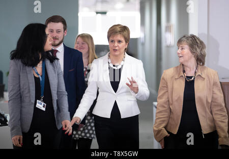 First Minister Nicola Sturgeon (centre) during a visit to Tay House, Glasgow, where she met with EU nationals working at the University of Glasgow ahead of next week's European election. - Stock Image