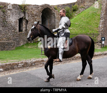 Close-up of a mounted Knight in full Armour getting ready to take part in an English Heritage Jousting Tournament at Dover Castle,  August 2018 - Stock Image