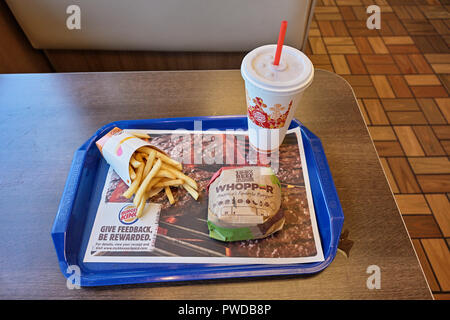 Burger King whopper hamburger, french fries and cold drink meal on the fast food restaurant dinner tray. - Stock Image