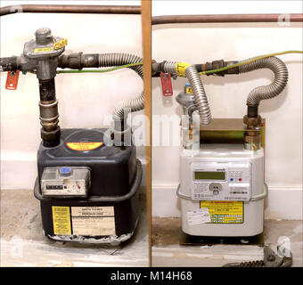 The old type analoge gas meter on the left and its replacement digital metric replacement on the right - Stock Image