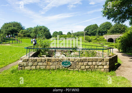 The stone base of the cotton mill steam engine at the former Burrs cotton mill, which now forms part of Burrs Country Park, Bury, Greater Manchester.  - Stock Image