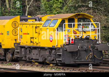 Schweerbau rail milling train parked in a siding at Woodford Underground station, Essex, England - Stock Image