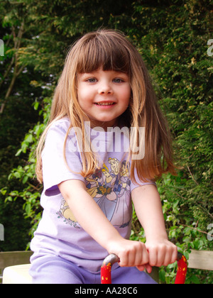 Young girl on see saw - Stock Image