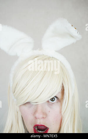Young woman wearing bunny ears for easter - Stock Image
