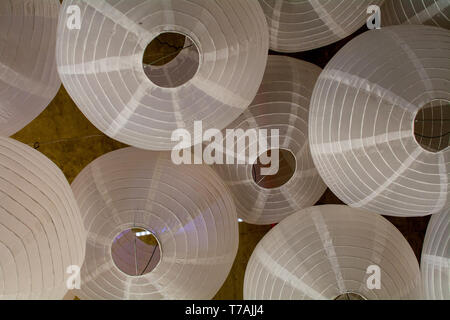 Festive background of Japanese lanterns white viewed from below- large happy copyspace - Stock Image
