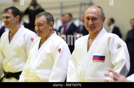 Russian President Vladimir Putin with the head coach of the Russian judo team Ezio Gamba, center, during judo practice at the Yug-Sport Training Centre February 14, 2019 in Sochi, Russia. - Stock Image