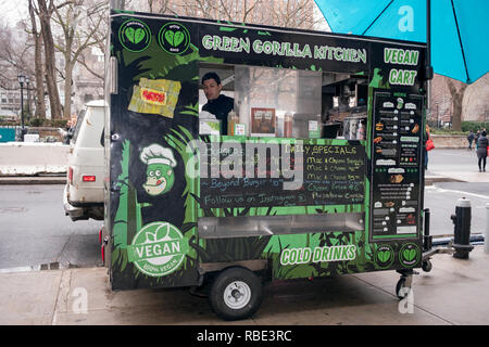The GREEN GORILLA KITCHEN, a vegan food cart trailer parked on the perimeter of Union Square Park in downtown Manhattan, New York City. - Stock Image