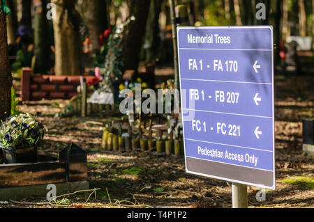 Sign to memorial trees in a cemetery - Stock Image
