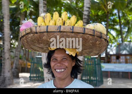 A fruit vendor on Long Beach in Boracay, Philippines. - Stock Image
