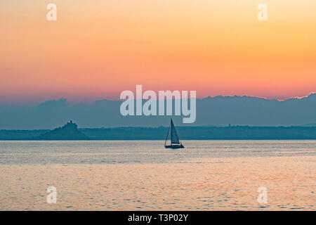 Newlyn, Cornwall, UK. 11th Apr, 2019. UK Weather. A chilly but glorious start to the day at Newlyn at sunrise, as this yacht makes for the harbour at Newlyn. Credit: Simon Maycock/Alamy Live News - Stock Image