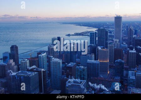 Chicago skyline and skyscrapers at dusk and twilight, with lake michigan at the side. - Stock Image