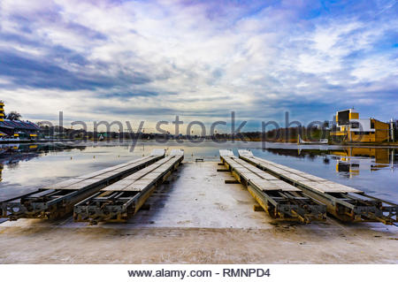 Poznan, Poland - February 10, 2019: Boat launch platforms in front of a artificial lake in the Malta park on a cloudy day. - Stock Image