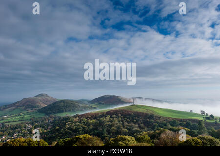 Mist swirls around Hazler Hill, with Helmeth Hill, Caer Caradoc and Hope Bowdler in the clear, Church Stretton, Shropshire - Stock Image
