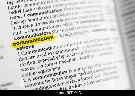 Highlighted English word 'communication' and its definition at the dictionary. - Stock Image