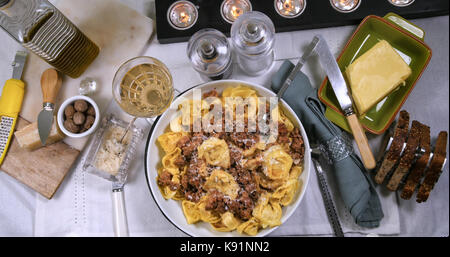 Top down view of delicious steamy tortellini in bolognese sauce (pasta) - Stock Image